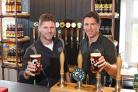 Rob Theakston (left) and Jo Theakston (right) raise a pint to Black Sheep Brewery's World Beer Award success