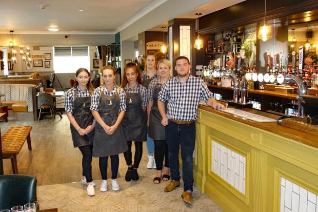 Bar staff and Michael Crane in The Fox