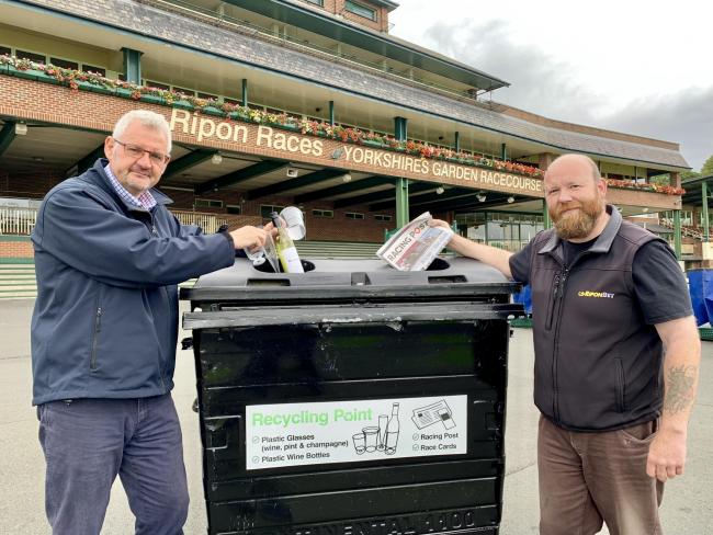 Matthew Pearson, left, and Carl Tonks with one of the new recycling bins
