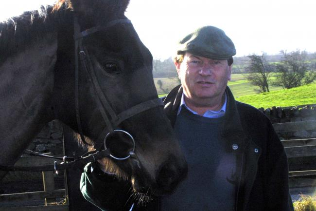 Racing North..Race horse trainer Alan Swinbank pictured at his Stables near Melsonby with 'Sikasso'..Pic: Mike Urwin..