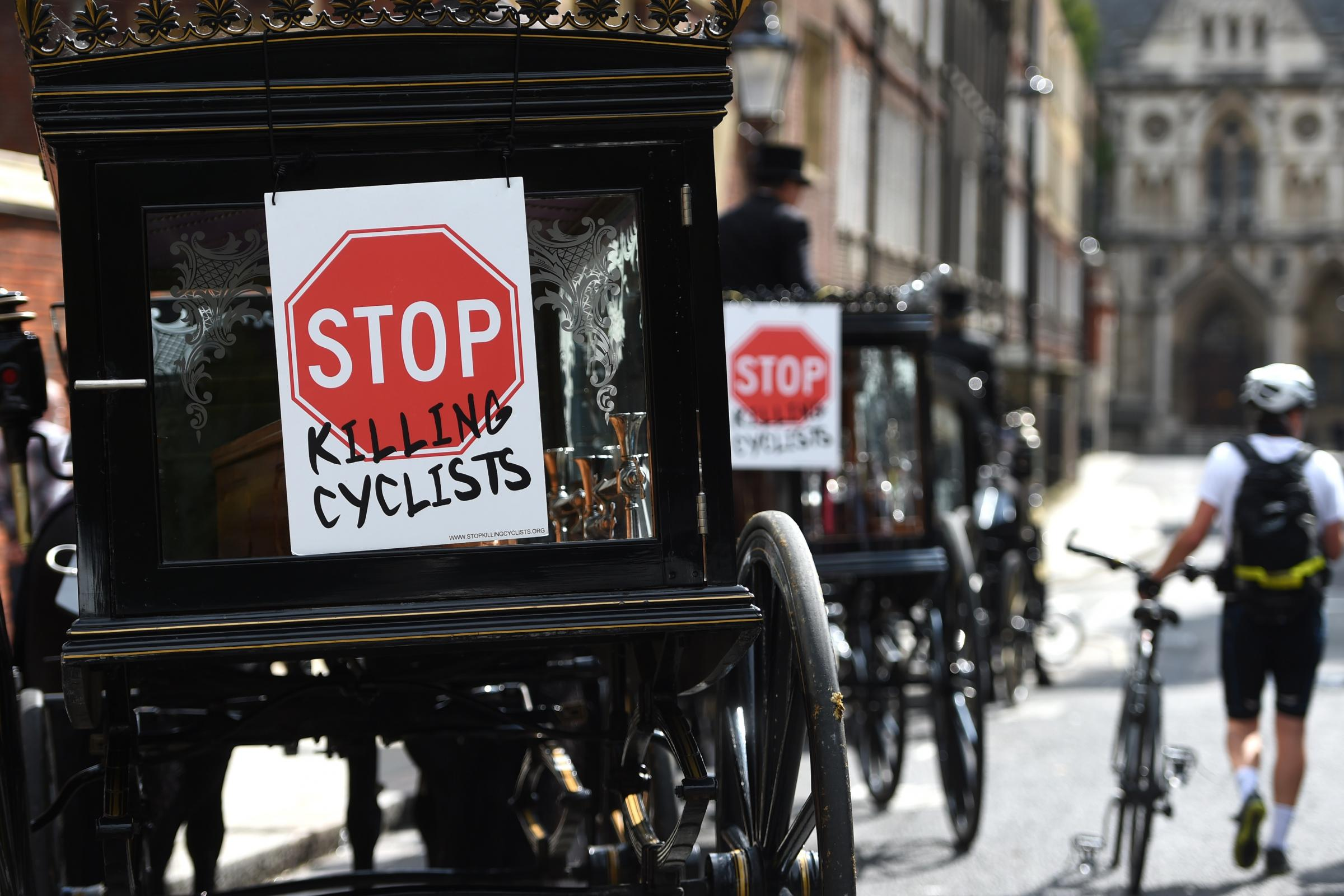 Protesters stage 'die in' to highlight cyclist deaths