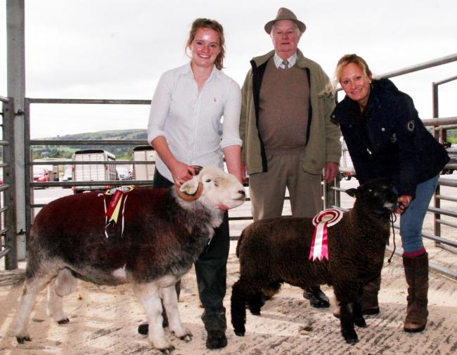 Milly Eaton, left, with her native breed Herdwick ram champion, joined by Dr Rebecca Clavell-Bate and the reserve champion Coloured Ryeland, and judge Alan Parnaby – Picture: Moule Media, Skipton