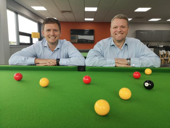 Partners James Dale and Andy Dewing enjoy a game of pool