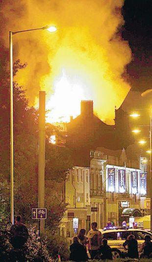 ALIGHT: The fire at the King's Hotel, in August last year