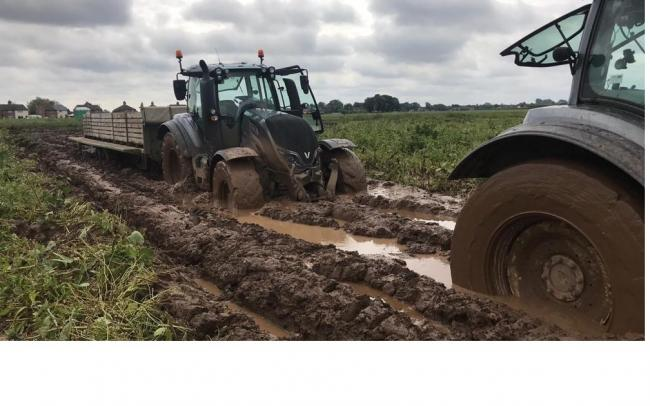 Tractors bogged down after constant wet weather makes harvesting impossible – Picture: NFU