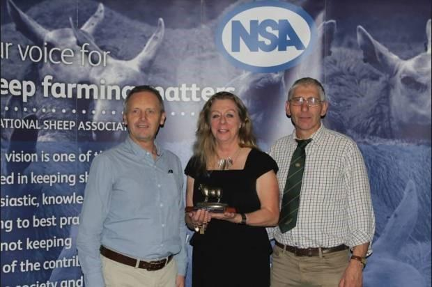Sheep consultant, Lesley Stubbings with her award, presented by NSA Chief Executive, Phil Stocker (left) and NSA Chairman Bryan Griffiths