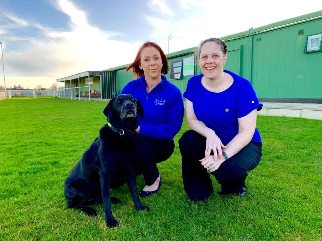 Caremark (Redcar and Cleveland) Care Manager Michelle Jackson (left) with Kelly Brearley and Acer the Caremark dog outside the clubhouse at Redcar Town Football Club