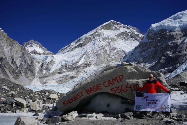 Mitchell Smith displays the flag at Everest Base Camp