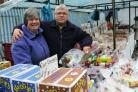 LONG SERVICE: Norman and Pat Hudson on their market stall in Stockton