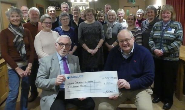 Thornton Watlass Choir presents a cheque for £500 to Bedale Community Library