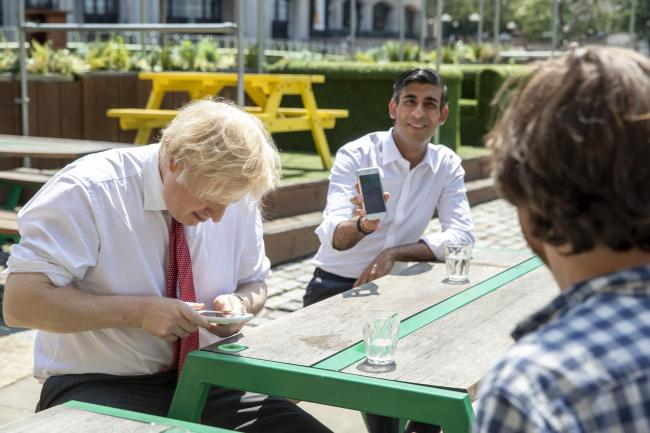 Richmond MP and Chancellor of the Exchequer Rishi Sunak, centre, during a visit to the Pizza Pilgrims restaurant in east London, with Prime Minister Boris Johnson  Picture: HEATHCLIFF O'MALLEY/THE DAILY TELEGRAPH/PA