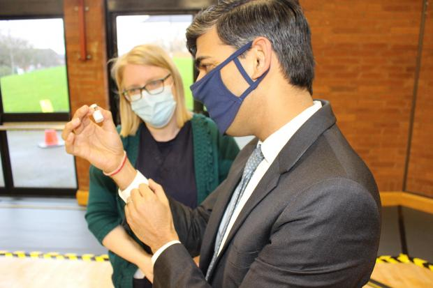 Rishi Sunak holding a vial of the Pfizer-BioNTech vaccine at the Northallerton Forum vaccination hub