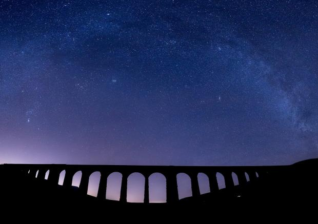 Darlington and Stockton Times: The night sky at the Ribblehead Viaduct in the Yorkshire Dales National Park Picture: ANDY WARD