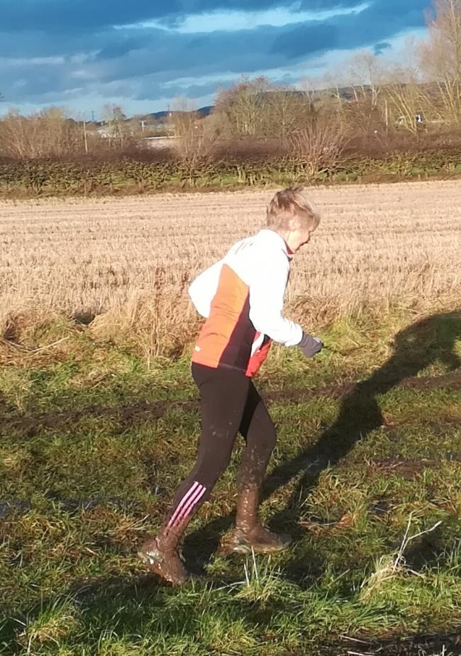 A muddy Christine Burn near the finish of the virtual Ormesby race