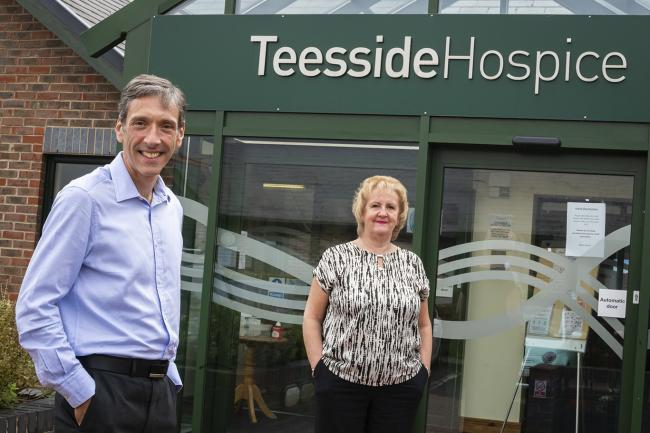 Teesside Hospice Chief Executive, David Smith with Christine Nolan, Erimus Insurance Brokers company secretary