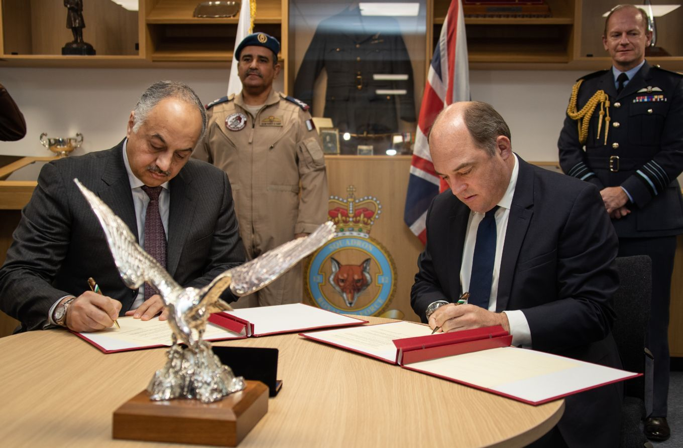 The UK and Qatar Defence Secretaries both signed the agreement. They are pictured pre-Covid