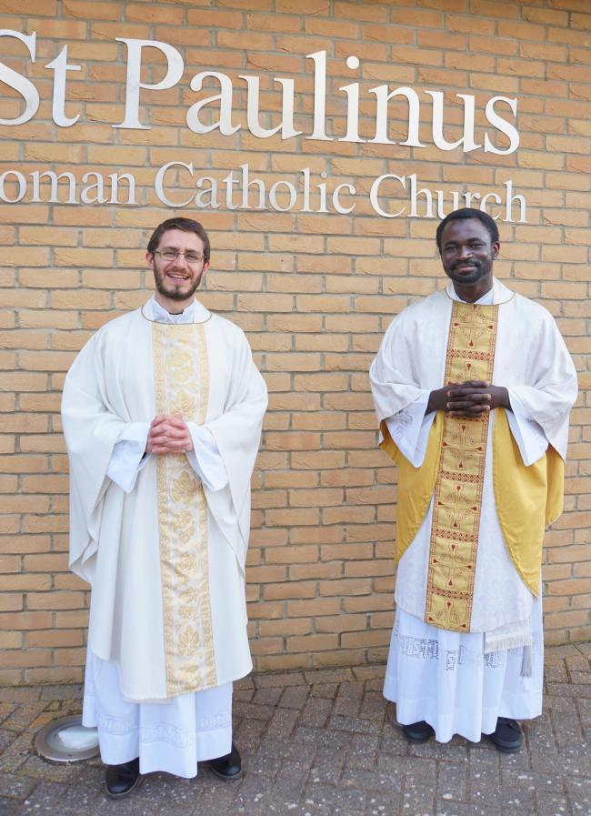 Fr Philip Cunnah (l) and Fr Ghamsi (r) outside St Paulinus Church after Mass on Saturday
