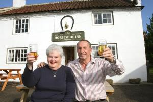WELCOMING HOSTELRY: Ann and Stan Taylor outside the Horseshoe Inn, West Rounton