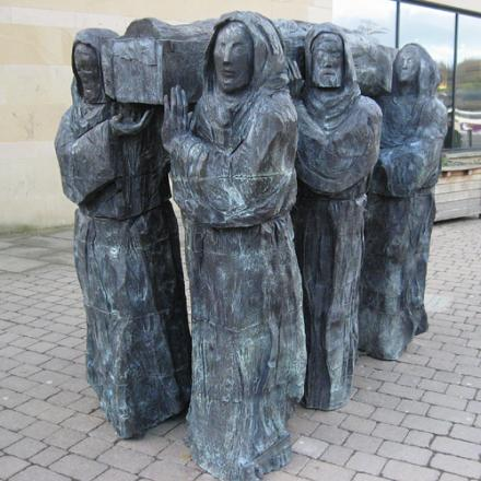 A sculpture showing the monks carrying the body of St Cuthbert in Durham