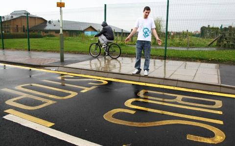 LONG WAIT: Bryon Williams at the bus stop markings in Ingleby Moor Crescent