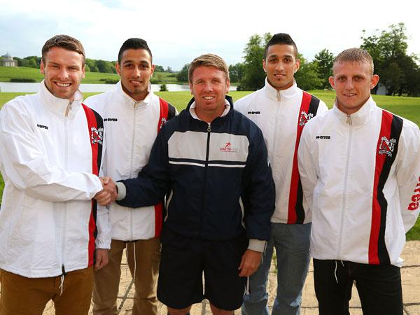 Darlington manager Martin Gray, centre, greets his latest signings. From left to right are Stephen Harrison, Arjun Purewal, Amar Purewal and David Dowson