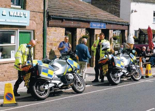 CAUSING OUTCRY: Police motorcyclists parked next to no-waiting cones in Hawes