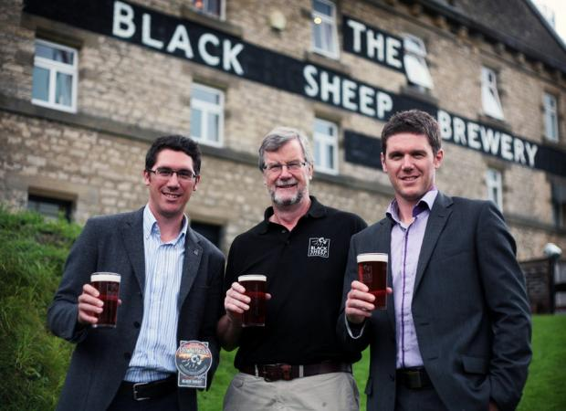 CHEERS: Celebrating Black Sheep Brewery's 20th anniversary, from left, Jo, Paul and Rob Theakston with a pint each of the Progress ale