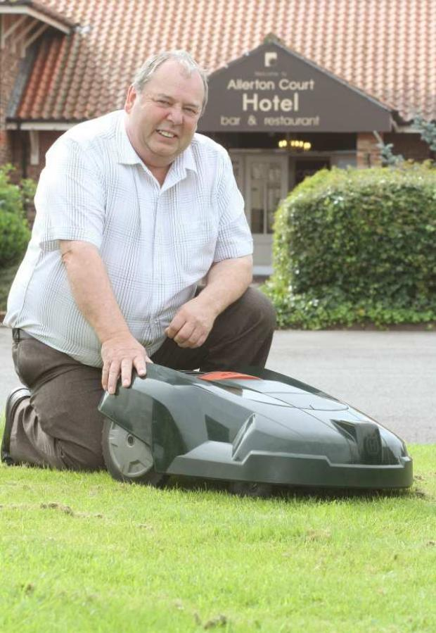 CUTTING EDGE: Martin Coleman with the robot lawnmower