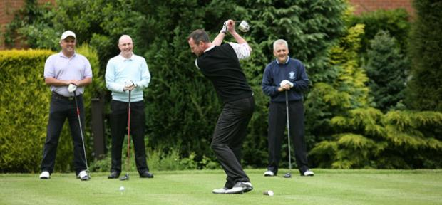 Golfers take part in a charity golf day at Blackwell Golf Club