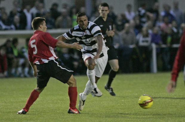 SHOCK LOSS: Darlington's Leon Scott and Guisborough's Mark Casey go for the ball