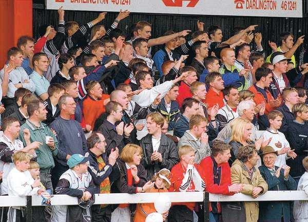 FAN FAVOURITE: Fans in the Tin Shed during a game against Chester City in May 1999