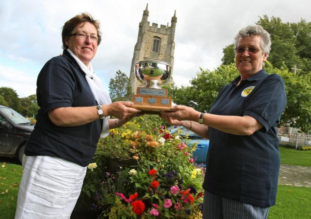 TOWN DELIGHT: Sedgefield in bloom, supporters Rosemary Burnip, left, and Norma Neal with their trophy