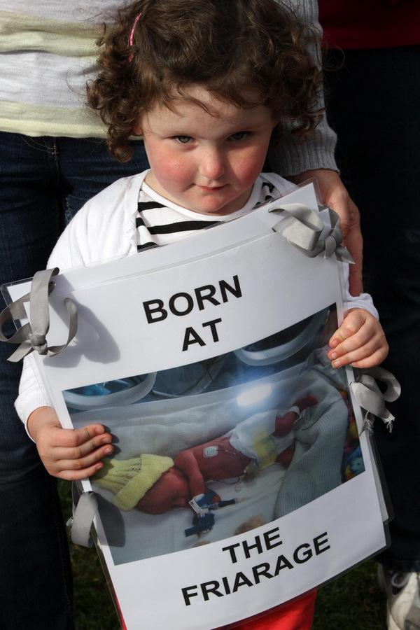DAY OF PROTESTS: Three-year-old Maddison Day holds a photograph of herself when she was a newborn baby, at a protest outside the Friarage Hospital