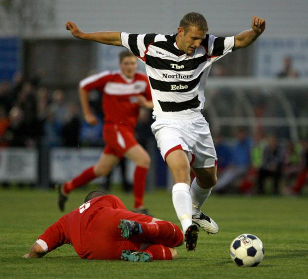 GOALSCORER: Darlington striker David Dowson in action against Newton Aycliffe last night. Goals: Dowson (77, 1-0) His goal proved to be the difference between the sides