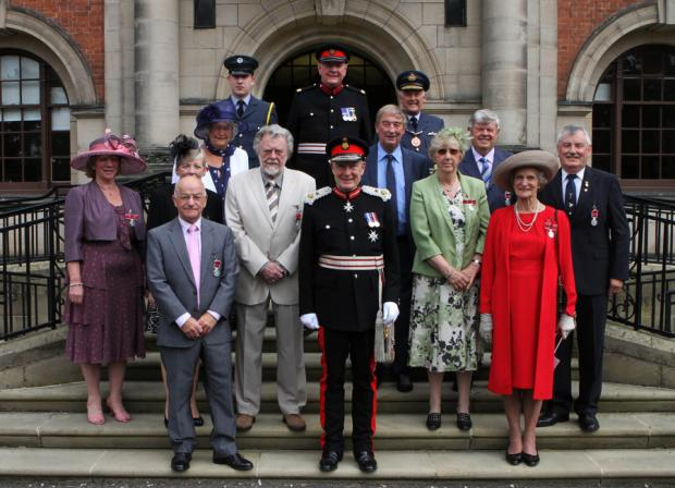 TEN OF THE BEST: The British Empire Medal recipients at county hall, Northallerton