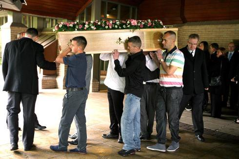 Rachel's coffin is carried into the chapel