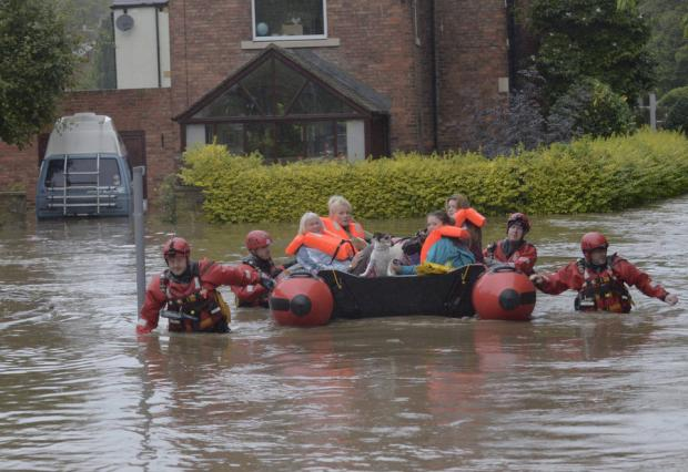 TIME TO LEAVE: Rescue teams come to the aid of stranded residents in Morpeth, Northumberland
