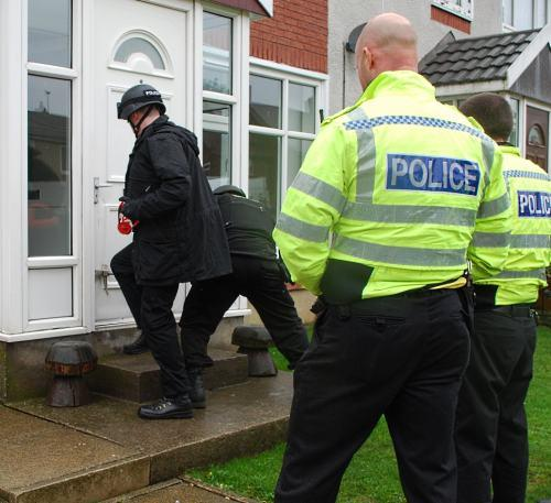 Police enter the house