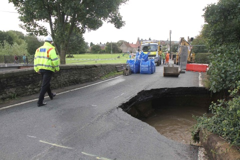HOLE IN ROAD: The bridge at Scorton which has been washed away by flood water
