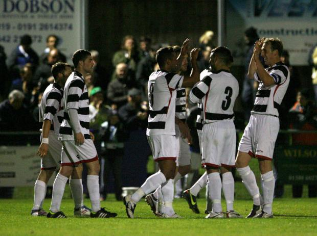 GOAL: Darlington celebrate Leon Scott's first-half goal - Picture: Chris Booth