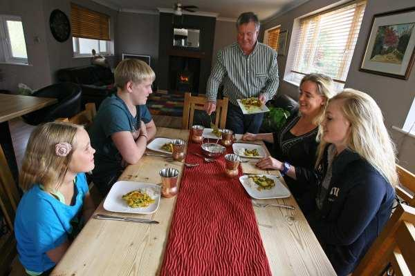 SPICE UP YOUR LIFE: Curry mad Dan Toombs has been serving up spicy dishes to his family every day for the past 20 months, from left, Jennifer, nine, Joe 13, wife Caroline and Katy, 15