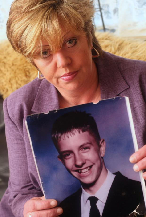 DRIVEN BY LOSS: Theresa Cave with a picture of her son, Chris