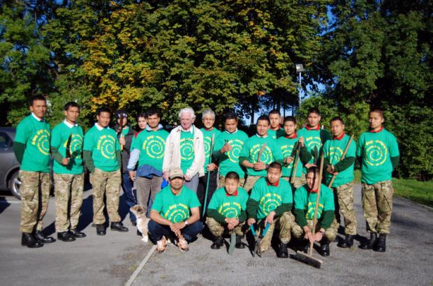 READY FOR ACTION: The Gurkhas who were involved in the clean-up operation, with Scotton residents