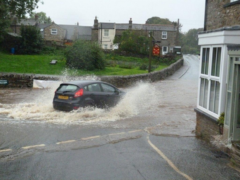 AWASH: A car ploughs through flood water in Bellerby