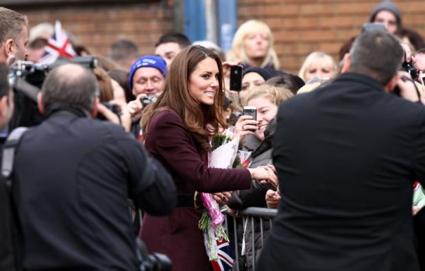 CHEERS: The Duchess of Cambridge meets the public during her visit to Stockton. Below, people gather on William Street