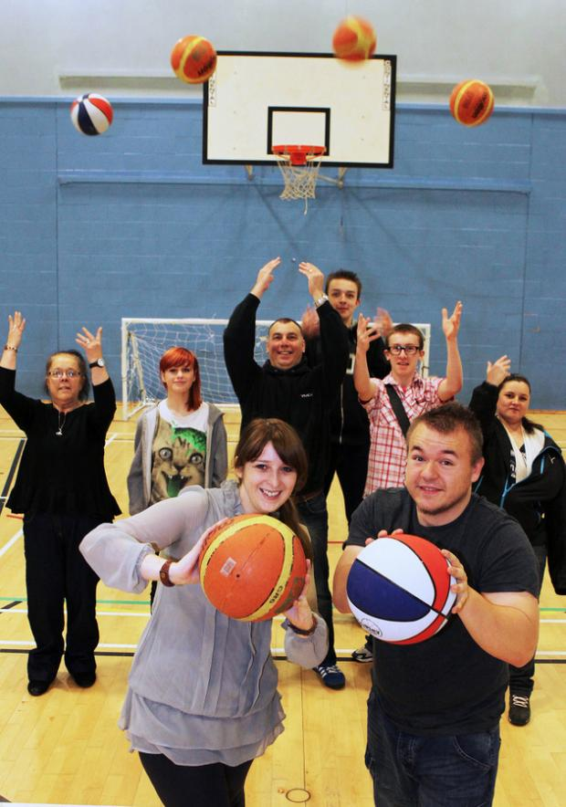 RECORD AIM: Rachel Wilkinson, volunteer co-ordinator for Tees Valley YMCA, and volunteer Daniel Hewitt take part in the YMCA world record attempt with other basketball enthusiasts