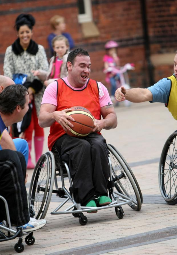 WHEEL CHALLENGE: People try wheelchair basketball at the free taster day in Stewart Park, Middlesbrough