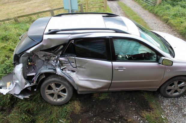 CRASH DAMAGE: The car near the track of the Wensleydale Railway after being hit by a train on Saturday