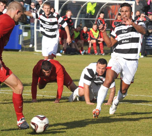 PRESSURE ON: Darlington's Leon Scott, right, challenges for the ball