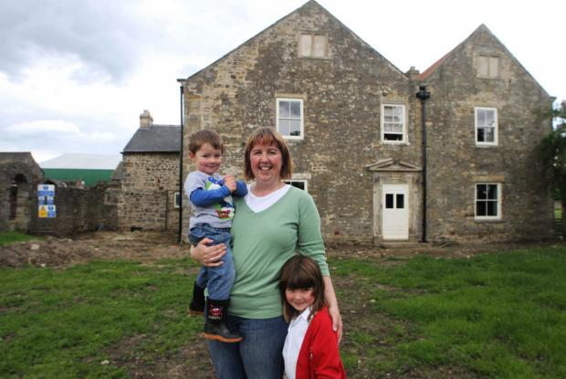 HOME: Donna Scott with her son Liam, two, and daughter Rebecca, five, at historic Middridge Grange